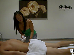 Sexy Asian masseuse gives rides a guy while massaging him