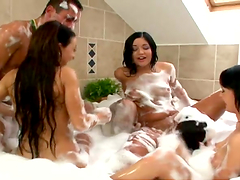 Horny brunettes share a big cock in a threesome