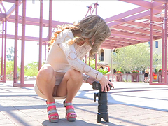 Sexy blonde teen plays with her pussy in public