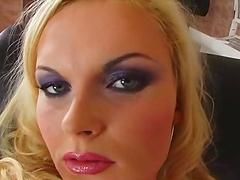 Horny blonde masturbates with a squash in solo clip