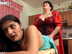 Mature lesbians fuck one another with a strapon