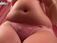 Chubby blonde fingers her wet pussy in solo clip