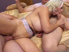 Busty bitch takes on two hard dicks