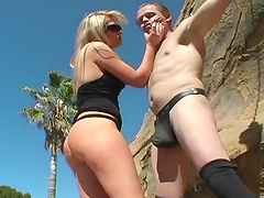 Dominant bitch with submissive fucker outdoors