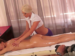 Lesbian moment among a client and a horny masseuse