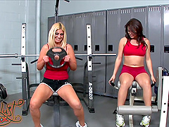 Kinky babes have a lesbian moment after their daily routine in the gym