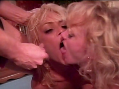 Slutty blondes share a big cock in a vintage threesome