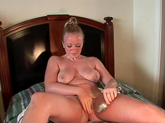 Flattering Blonde Solo Model Inserting A Spoon In Her Shaved Pussy