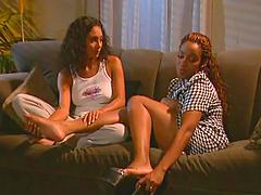 Ebony babes please each other in a lesbian scene