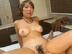 Enticing Asian cowgirl giving titjob then hammered