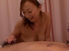 Naughty Japanese slut sucks on a patient's dick