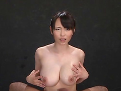 Busty Jap babe gives cock shaped dildo a titjob