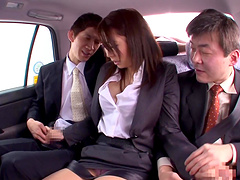 Businessmen toy with chick in the backseat