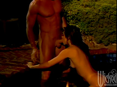 Rough sex with a busty brunette in the pool