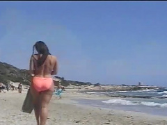 Rough sex with a busty brunette on the beach