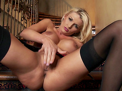 Provocative MILF Alicia Secrets fingers her pussy on the stairs