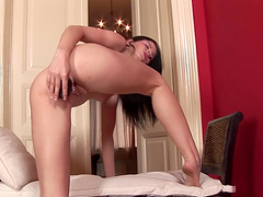 Dirty model Judy Smile fingers her pussy while pissing on the toilet