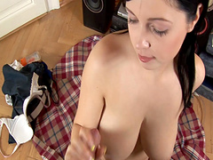 Closeup video of a busty babe sucking a large dick on her knees