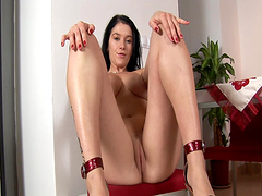 Busty brunette in high heels knows how to pleasure her cravings