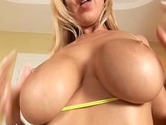 Sexy blondie moans while drilling her pussy and squirts. HD