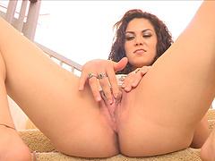 Sweet brunette spreads her long legs to masturbate for the webcam