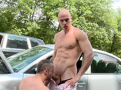 Two muscular guys drop their clothes to have hardcore outdoors sex