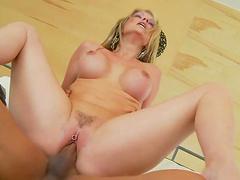 Blonde whore rides a hard fuckin' dick