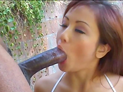 Great outdoors interracial scene with the Asian beauty Tia Tanaka