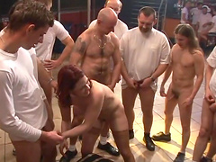 Redhead bitch gets fuckin' gangbanged by a group of fuckers!