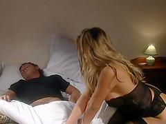 Blonde whore sucks and licks a cock