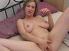 Sandra masturbates with a dildo while squeezing her big tits