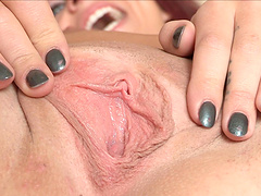 Gorgeous Madelyn plays with her pussy while on her bed