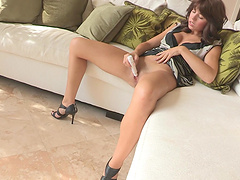 Kinky brunette in high heels enjoys pleasuring her puss with toy