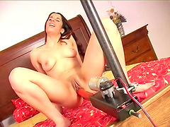 Dirty brunette fucked by a fuckin' machine
