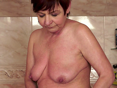Horny mature sucks a stud's cock in the shower before being fucked