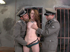 Misha Cross is fucked by two officers in a threesome