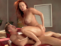 Redhead MILF Janet Mason gives a titjob and gets a facial