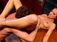 Brunette chick Lizz Tayler spreads her long legs to ride cowgirl style